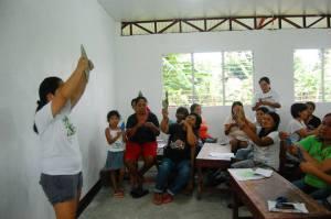 Monica Manluluyo, Volunteer Coordinator of the Psychology Volunteers on Bikes, teaching the art of paper folding or origami