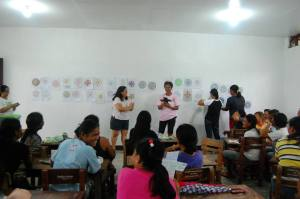 Edna Lee, co-founder of the Psychology Volunteers on Bikes, facilitating the sharing of the women after their art group activity