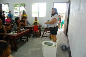 Edna Lee talking about the use of composting toilets