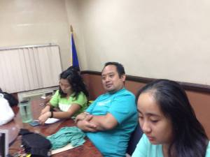 Volunteers Mishka Watin and Monica Manluluyo together with Joel Lee