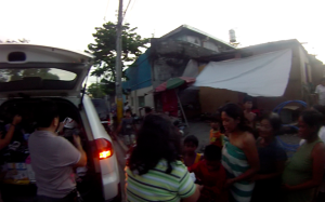 Fire survivors in Brgy. Lorega line up to receive the goods shared by the volunteers