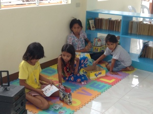 Children playing with the boardgames