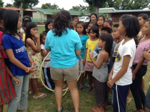 PVOB Co-founder Mishka Watin explaining the purpose of the hulahoop game